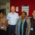 HREA's Director of Programmes, Frank Elbers (right), with staff of the Human Rights and Police Project at Victoria Police headquarters in Melbourne